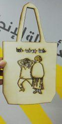 صنع ديكور للحديقه حقيبه من خشب