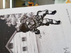 (ثانوية نورة الجبر الإحساء) ملصق رجل فضائي على دفتر